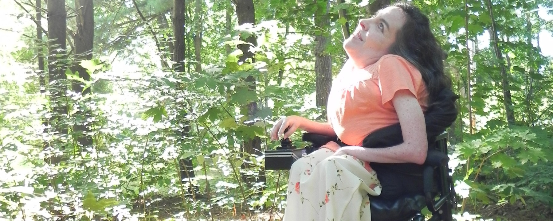 Christina Chase is disabled and enjoys nature in her wheelchair