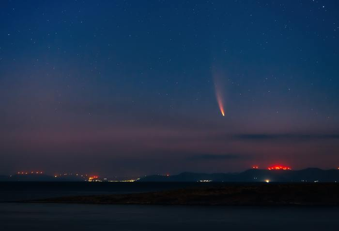 fireball of a meteor descending upon a city