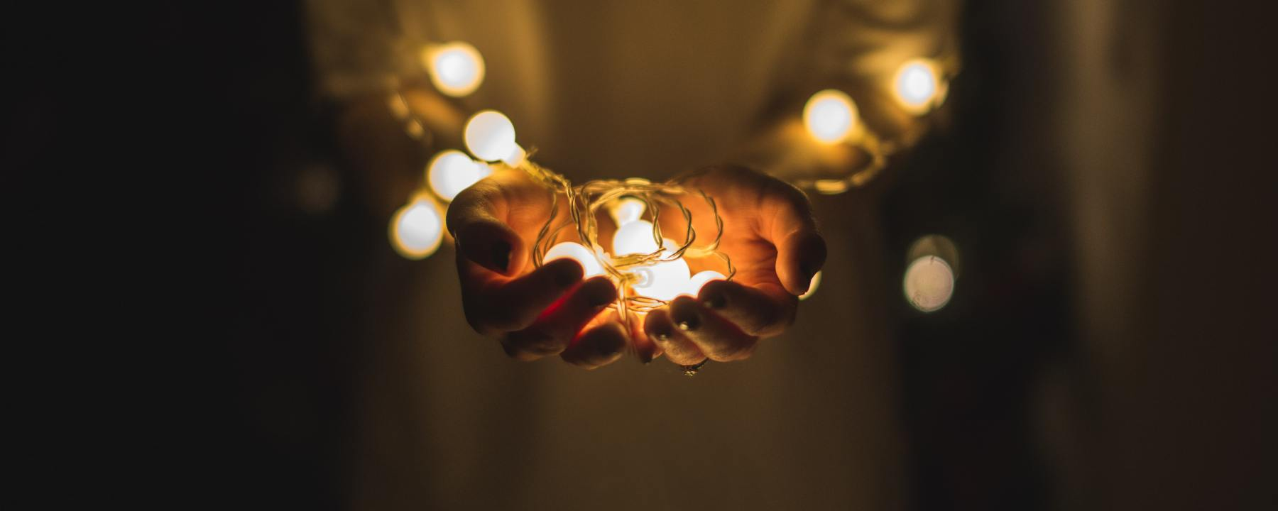hands filled with light